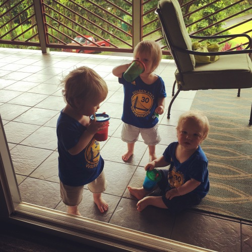Triplets enjoying drinks on the spacious lanai at our rental.